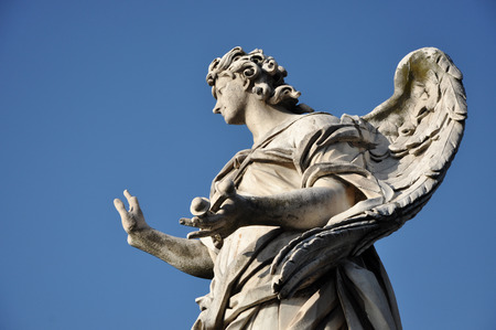 animal angelic: Angel with the Nails. Statue on the Ponte Sant Angelo bridge, Rome Stock Photo