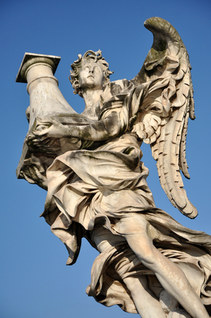 animal angelic: Angel statue against blue sky. Rome, Italy