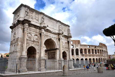 constantine: ROME, ITALY - MARCH 16, 2016: Tourist visiting the triumphal Arch of Constantine near the Colosseum in Rome, Italy