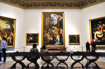 VATICAN, ITALY - MARCH 15, 2016: Tourists visiting the Pinacoteca Art Gallery in the Vatican museums where the World most famous painters works are exhibited