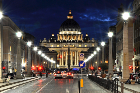 saint peter: VATICAN CITY, ITALY - MARCH 17, 2016: Tourists visiting the Saint Peter square at night. This part of the Vatican city is opened all the night