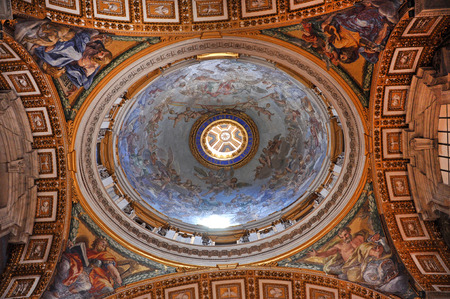 decades: VATICAN, ITALY - MARCH 16, 2016: The ceiling of the Saint Peter basilica was painted over decades and is visited daily by thousands of tourists and religious people