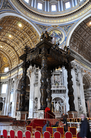 bernini: VATICAN, ITALY - MARCH 16, 2016: The famous wooden baldachin, altar of Saint Peter basilica was made by Bernini and is visited daily by thousands of tourists