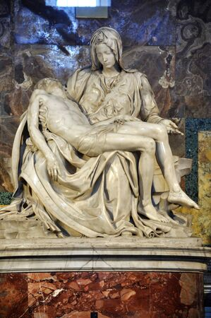 cradling: VATICAN, ITALY - MARCH 16, 2016: The famous sculpture of Pieta in the Saint Peter basilica was made by Michelangelo and is visited daily by thousands of tourists