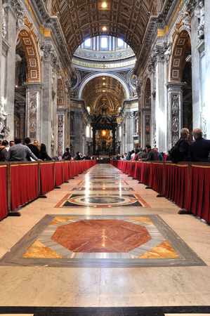 basilica of saint peter: VATICAN, ITALY - MARCH 16, 2016: The famous Saint Peter basilica is the biggest church in the World and is visited daily by thousands of tourists and religious people Editorial