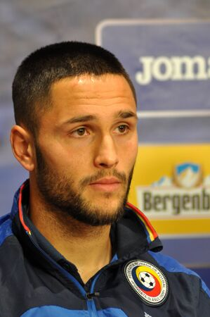 florin: CLUJ-NAPOCA, ROMANIA - MARCH 26, 2016: Player of the Romanian National Football Team, Florin Andone speaks during a press conference before the match against Spain