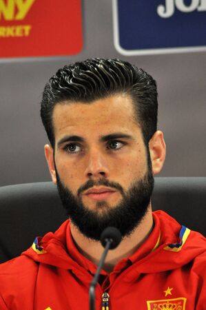 nacho: CLUJ-NAPOCA, ROMANIA - MARCH 26, 2016: Spanish football player Nacho Fernández Iglesias speaks during a press conference before the Romania-Spain friendly match