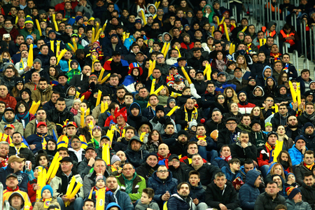 ultras: CLUJ-NAPOCA, ROMANIA - MARCH 27, 2016: Crowd of people supporting their team during a friendly football match between Romania against Spain, both of them qualified for Euro 2016 in France Editorial