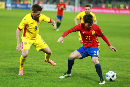 midfielder: CLUJ-NAPOCA, ROMANIA - MARCH 27, 2016: David Silva (red) player of Manchester City and the Spain national team playing against Romania before Euro 2016 Editorial