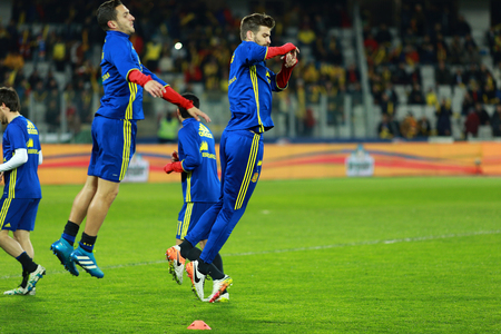 gaspar: CLUJ-NAPOCA, ROMANIA - MARCH 27, 2016: Soccer players of the National Team of Spain exercising during the warm-up session before a match against Romania in Cluj Arena stadium