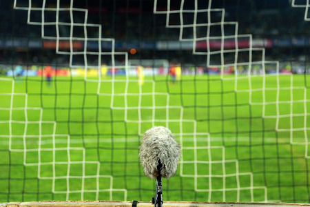 professional sport: Professional sport microphone on a soccer field behind the net Stock Photo