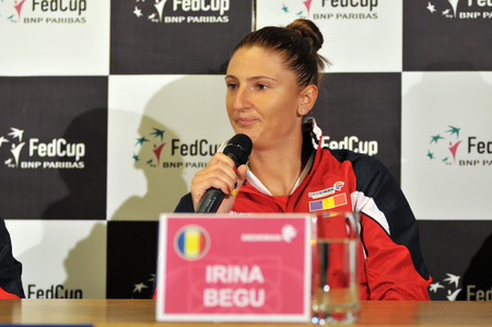 paribas: CLUJ-NAPOCA, ROMANIA - APRIL 13, 2016: Romanian tennis player Irina Begu answering questions during the press conference before Tennis Fed Cup by BNP Paribas World Cup Play-Offs match Romania vs Germany Editorial