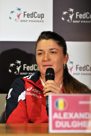 alexandra: CLUJ-NAPOCA, ROMANIA - APRIL 13, 2016: Romanian tennis player Alexandra Dulgheru answering questions during the press conference before Tennis Fed Cup by BNP Paribas World Cup Play-Offs match Romania vs Germany