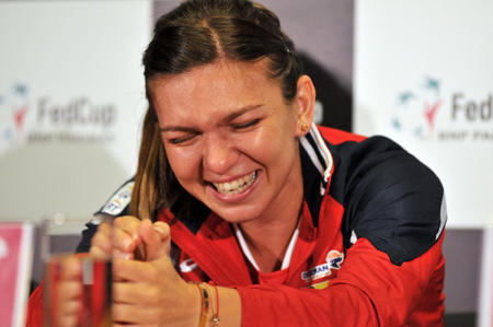are fed: CLUJ-NAPOCA, ROMANIA - APRIL 13, 2016: Romanian tennis player Simona Halep  during the press conference before Tennis Fed Cup by BNP Paribas World Cup Play-Offs match Romania vs Germany
