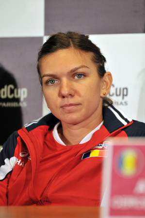 paribas: CLUJ-NAPOCA, ROMANIA - APRIL 13, 2016: Romanian tennis player Simona Halep answering questions during the press conference before Tennis Fed Cup by BNP Paribas World Cup Play-Offs match Romania vs Germany