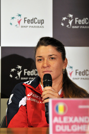 paribas: CLUJ-NAPOCA, ROMANIA - APRIL 13, 2016: Romanian tennis player Alexandra Dulgheru answering questions during the press conference before Tennis Fed Cup by BNP Paribas World Cup Play-Offs match Romania vs Germany
