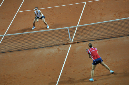 playoffs: CLUJ-NAPOCA, ROMANIA - APRIL 7, 2016: Germany plays Romania during a Fed Cup Women double tennis match in the World Cup Play-Offs