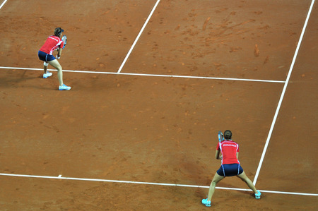 are fed: CLUJ-NAPOCA, ROMANIA - APRIL 7, 2016: Germany plays Romania during a Fed Cup Women double tennis match in the World Cup Play-Offs