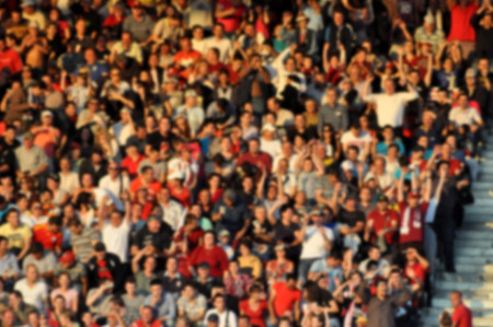 hundreds and thousands: Blurred crowd of spectators in a stadium