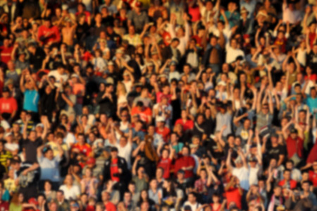 hundreds and thousands: Crowd in a stadium. Blurred heads and faces of spectators