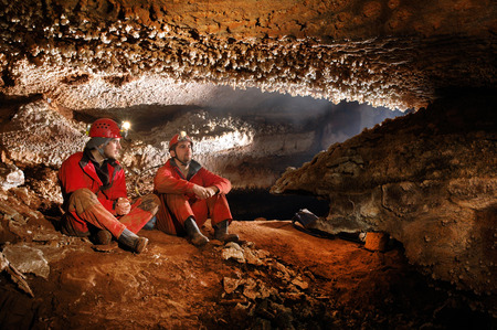 caving: Cavers exploring a beautiful cave