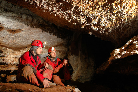 geologists: Geologists studying calcite minerals in a cave