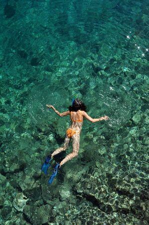 clear waters: Woman snorkeling in the crystal clear waters of Maldives
