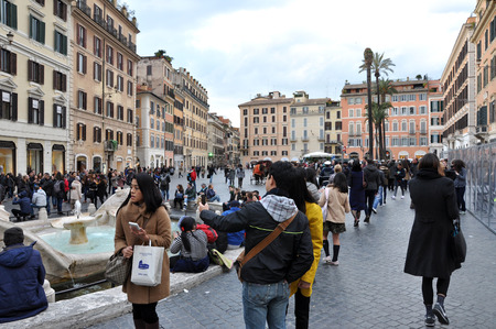 spanish steps: ROME, ITALY - MARCH 14, 2016: Tourists visiting the Piazza di Spagna (Spanish square), the Spanish Steps and the Fontana della Barcaccia in Rome