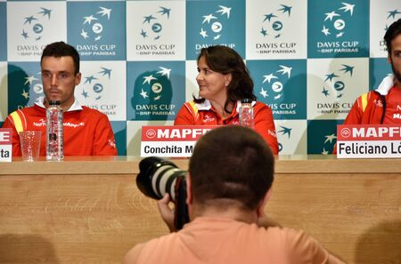 paribas: CLUJ-NAPOCA, ROMANIA - JULY 12, 2016: Photo reporters photographing during the press conference before Davis Cup by BNP Paribas match Romania vs Spain