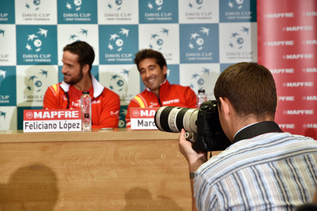 martinez: CLUJ-NAPOCA, ROMANIA - JULY 12, 2016: Photo reporters photographing during the press conference before Davis Cup by BNP Paribas match Romania vs Spain