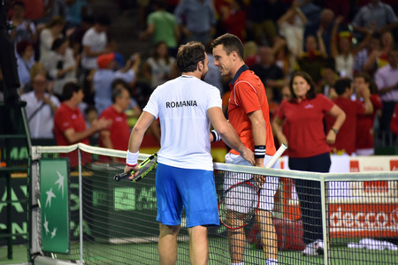 florin: CLUJ NAPOCA, ROMANIA - JULY 16, 2016: Tennis players shaking their hands at the final of a Davis Cup by BNP Paribas match Romania vs Spain