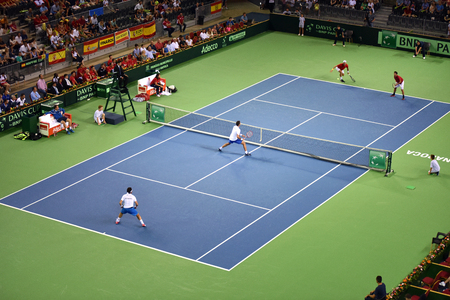 doubles: CLUJ NAPOCA, ROMANIA - JULY 16, 2016: Tennis players playing at a doubles match during a Davis Cup by BNP Paribas match Romania vs Spain
