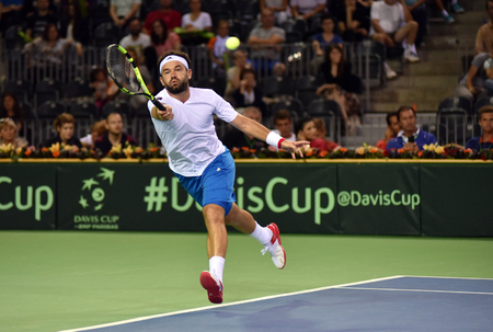 florin: CLUJ NAPOCA, ROMANIA - JULY 16, 2016: Romanian tennis player Florin Mergea playing during a match Davis Cup by BNP Paribas match Romania vs Spain