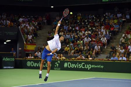 CLUJ NAPOCA, ROMANIA - JULY 16, 2016: Romanian tennis player Horia Tecau playing during a match Davis Cup by BNP Paribas match Romania vs Spain Editöryel