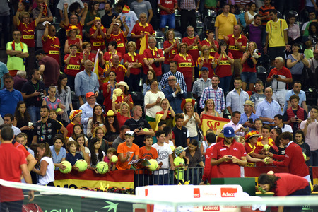 cheering fans: CLUJ NAPOCA, ROMANIA - JULY 16, 2016: Crowd of cheering people and fans enjoying a Davis Cup match by BNP Paribas Romania vs Spain Editorial
