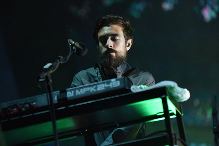 live performance: BONTIDA, ROMANIA - JULY 17, 2016: Keyboarder Kyle J Simmons of English band Bastille playing during a live performance at Electric Castle festival Editorial