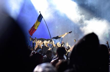 batten: BONTIDA, ROMANIA - JULY 15, 2016: Bass guitarist Chris Batten from Enter Shikari British rock band crowd surfing during a concert at Electric Castle festival