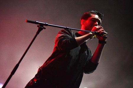 live performance: BONTIDA, ROMANIA - JULY 17, 2016: Singer Dan Smith of English band Bastille singing during a live performance at Electric Castle festival