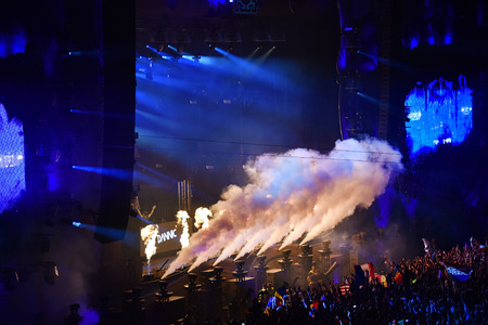 clubbers: CLUJ NAPOCA, ROMANIA - AUGUST 5, 2016: CO2 smoke cannons emitting smoke on the stage onto crowd at a Dannic concert during Untold Festival Editorial