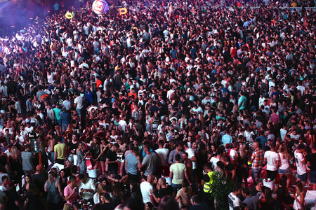 CLUJ-NAPOCA, ROMANIA - AUGUST 4, 2016: Large crowd of people joining a Fedde le Grand live concert at Untold Festival Editorial