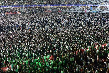 CLUJ-NAPOCA, ROMANIA - AUGUST 4, 2016: Stadium full with cheering crowd partying at a Faithless concert during the Untold Festival