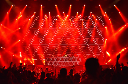 frequencies: CLUJ-NAPOCA, ROMANIA - AUGUST 7, 2016: Djs Lost Frequencies mixing live on the stage during the Untold Festival. Silhouette of partying crowd in the foreground