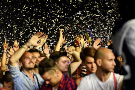 people partying: CLUJ-NAPOCA, ROMANIA - AUGUST 8, 2016: Crowd of people partying with raised arms and hands at a Afrojack concert during the Untold Festival
