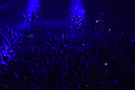 napoca: CLUJ NAPOCA, ROMANIA - JULY 8, 2016: Crowd having fun with raising hands at a Lost Frequencies live concert at Untold Festival, the Best Major Music Festival of Europe