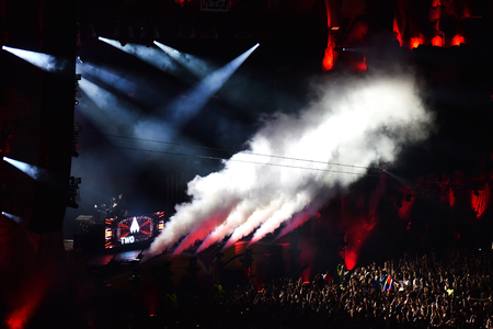 disc jockey: CLUJ-NAPOCA, ROMANIA - JULY 6, 2016: Disc jockey Twoloud mixing live on the stage in the front of crowd of people during the Untold Festival