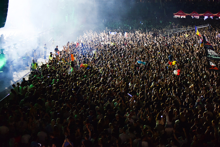 performace: CLUJ NAPOCA, ROMANIA - AUGUST 7, 2016: Crowd of people having fun and dancing during a Dj W&W concert at Untold festival