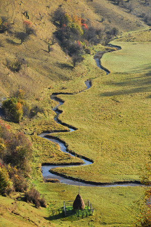 meandering: Meandering small watercourse in a green meadow Stock Photo