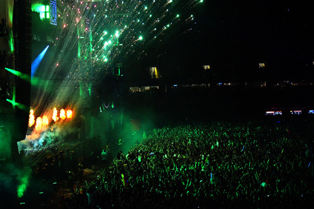 fiesta popular: CLUJ-NAPOCA, ROMANIA - AUGUST 7, 2016: Fireworks firing in the front of crowd at a Dj W&W concert performing live at Untold festival Editorial