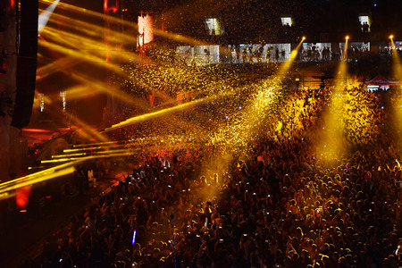 CLUJ-NAPOCA, ROMANIA - AUGUST 7, 2016: Confetti cannons throwing confetti from the stage over the crowd at a Dj Lost Frequency concert at the Untold Festival