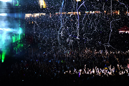people partying: CLUJ NAPOCA, ROMANIA - AUGUST 7, 2016: Crowd of people partying during a live W&W concert. Throwing confetti from the stage at Untold festival Editorial